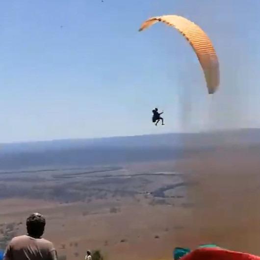 Hortuma yakalanan yamaç paraşütçü zor anlar yaşadı